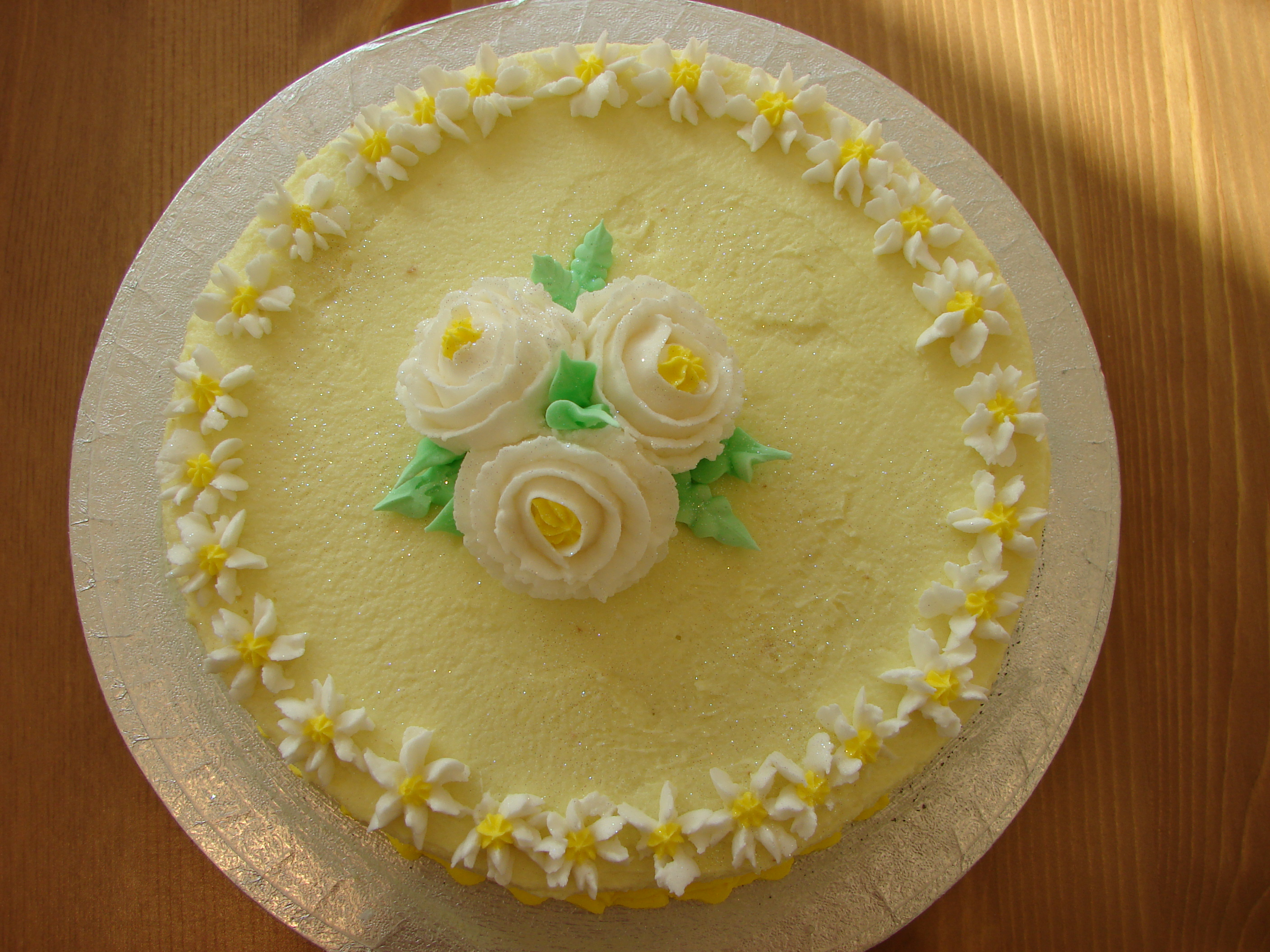 Lemon Drizzle Cake With Icing And Flowers
